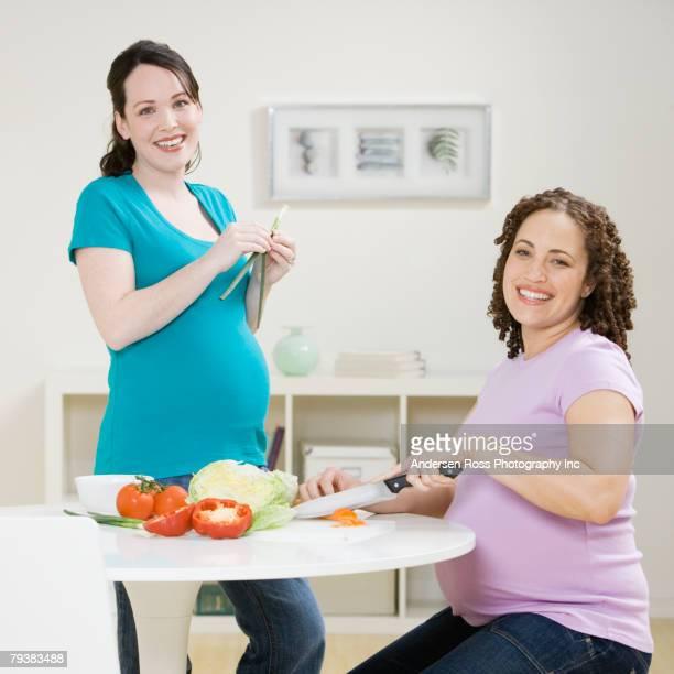 Multi-ethnic pregnant women preparing food