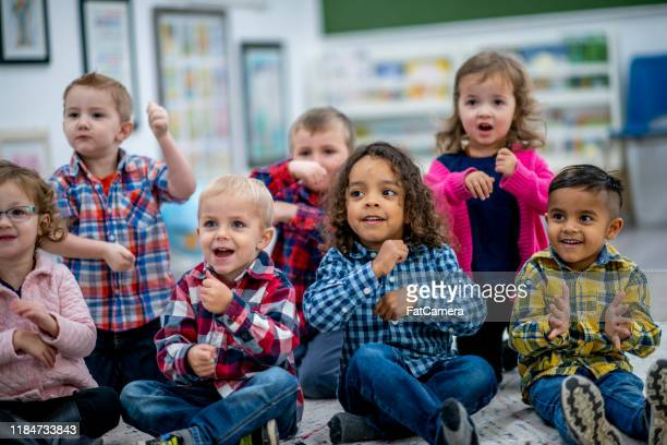 multi-ethnic preschool sing-along time stock photo - singing stock pictures, royalty-free photos & images