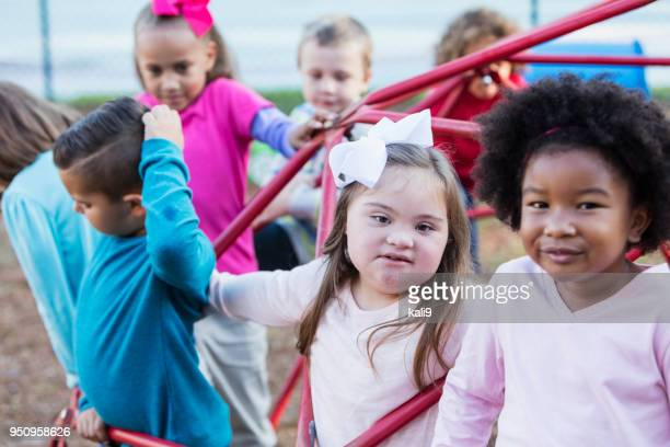 Multi-ethnic school children on playground monkey bars