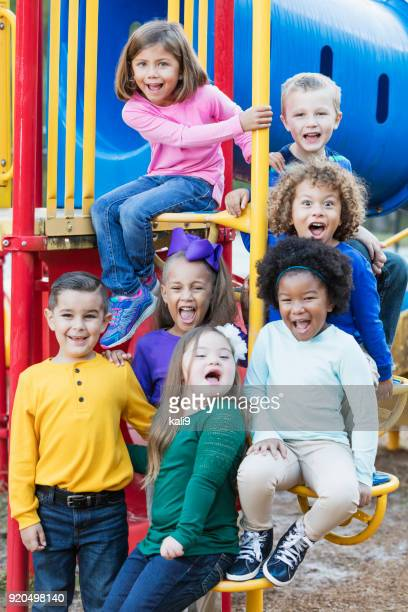 multi-ethnic school children on playground - vertical stock pictures, royalty-free photos & images