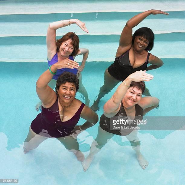 Multi-ethnic senior women exercising in swimming pool