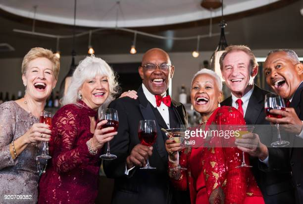 multi-ethnic seniors enjoying night out, drinking - formal stock pictures, royalty-free photos & images
