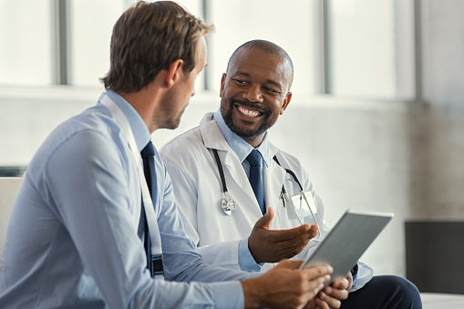 Multiethnic specialist doctors discussing case 1189302612