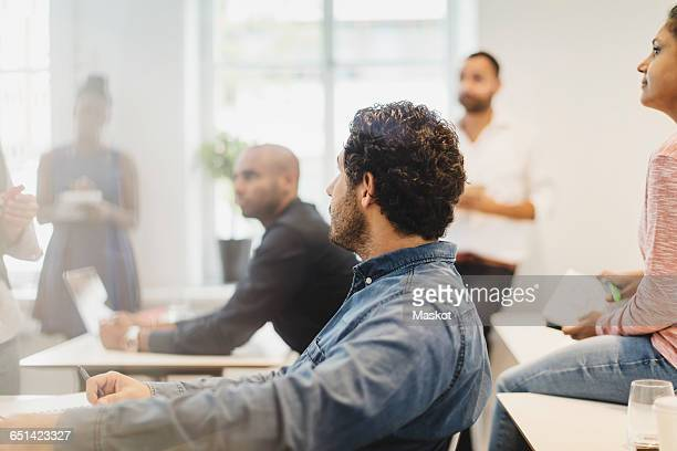 Multi-ethnic students concentrating in language class