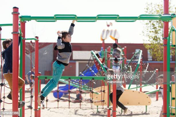 multi-ethnic students playing at schoolyard during the break time - playground stock pictures, royalty-free photos & images