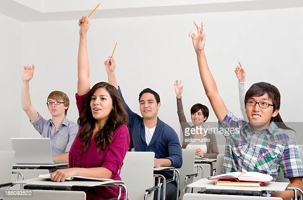 Multi-ethnic students raising hands