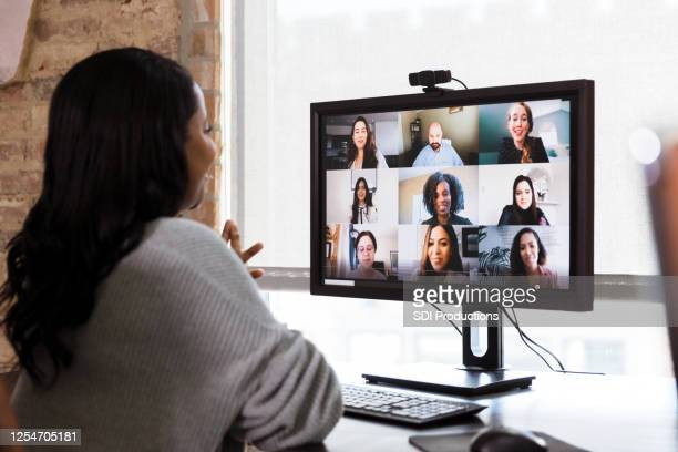 multi-ethnic team has meeting via video conference - employee engagement stock pictures, royalty-free photos & images