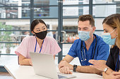 multiethnic group doctors medical experts wear