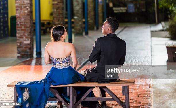 multi-ethnic teenage couple at prom, talking - prom dress stock pictures, royalty-free photos & images