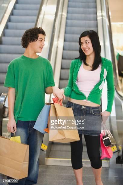 Multi-ethnic teenage couple in mall