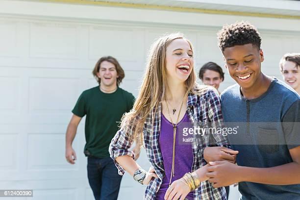 Multi-ethnic teenage friends laughing
