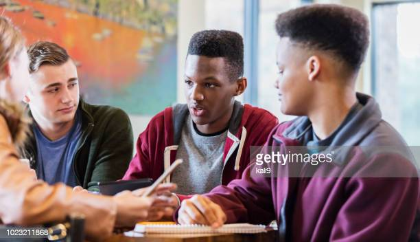 multi-ethnic teenage friends studying together - teenage boys stock pictures, royalty-free photos & images