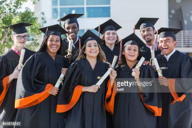 Multi-ethnic teenage graduates in cap and gown