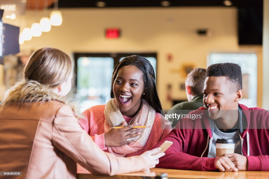 Multi Ethnic Teens Hanging Out In Coffee Shop : Stock Photo