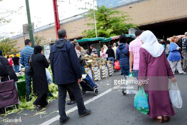 multi-ethnic weekend market in brussels midi - islam stock pictures, royalty-free photos & images