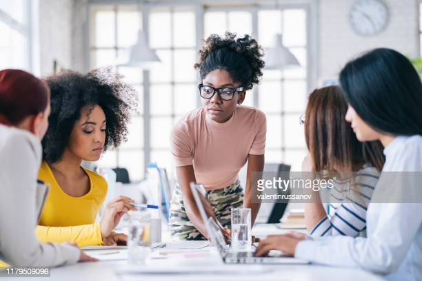 multi-ethnic women business team having discussion new projects - entrepreneur stock pictures, royalty-free photos & images