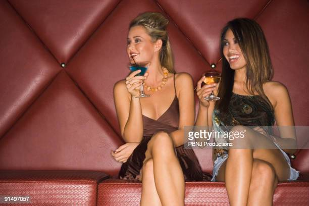 multi-ethnic women holding cocktails - beautiful filipina stock photos and pictures