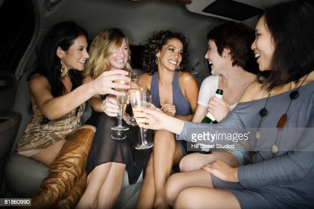 multi-ethnic women toasting with champagne - addio al nubilato foto e immagini stock