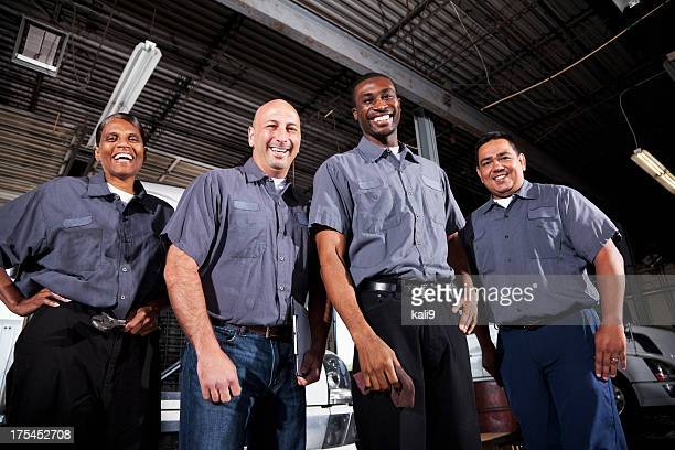 multi-ethnic workers at trucking facility - uniform stock pictures, royalty-free photos & images