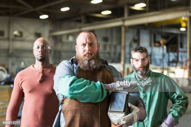 multi-ethnic workers in metal fabrication plant - welding stock photos and pictures