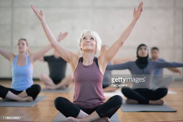 multi-ethnic yoga class stock photo - 30 39 years stock pictures, royalty-free photos & images