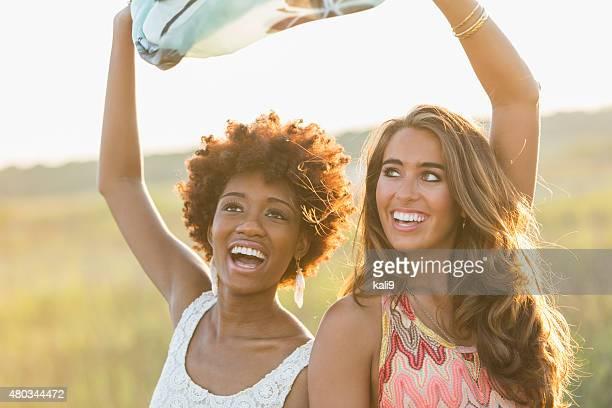 Multi-ethnic young women enjoying nature on summer day