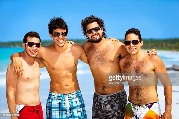 Multi-ethnics self confidence portrait of young men in tropical beach