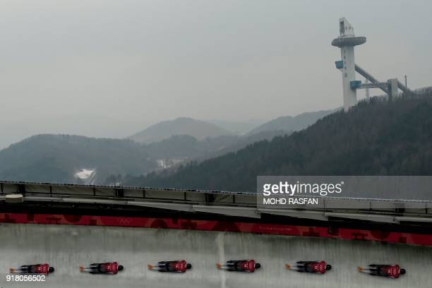 Multi-exposure picture shows Latvia's Martins Dukurs in his men's skeleton training session at the Olympic Sliding Centre, during the Pyeongchang...