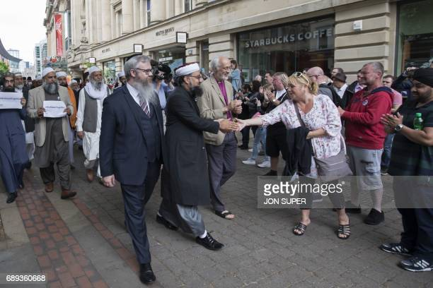 Multifaith leaders make their way to a gathering in St Ann's square for the victims of the Manchester bombing in Manchester on May 28 2017 A total of...