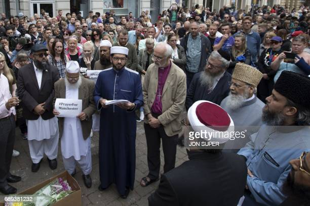 Multifaith leaders speak at a gathering for the victims of the Manchester bombing in St Ann's square in Manchester on May 28 2017 A total of 14...