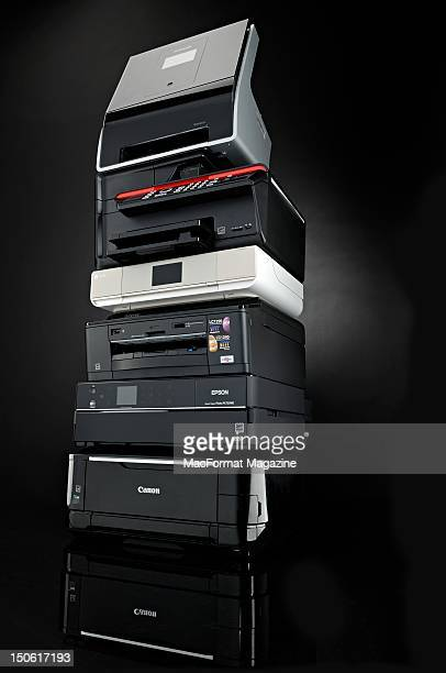 Multifunction inkjet printers stacked on top of each other Lexmark Genesis S815 Kodak Office Hero 61 HP Envy 110 AiO Brother MFCJ825DW Epson Stylus...