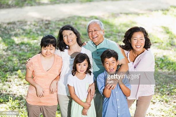 Multi-generation Asian family with autistic daughter