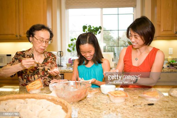 Multi-generation Chinese family cooking together