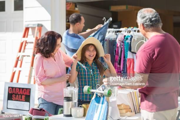 Multi-generation family at garage sale