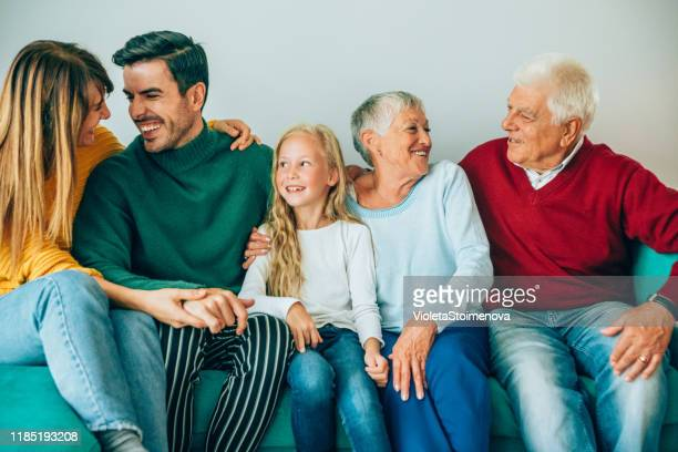 multi-generation family at home. - two generation family stock pictures, royalty-free photos & images