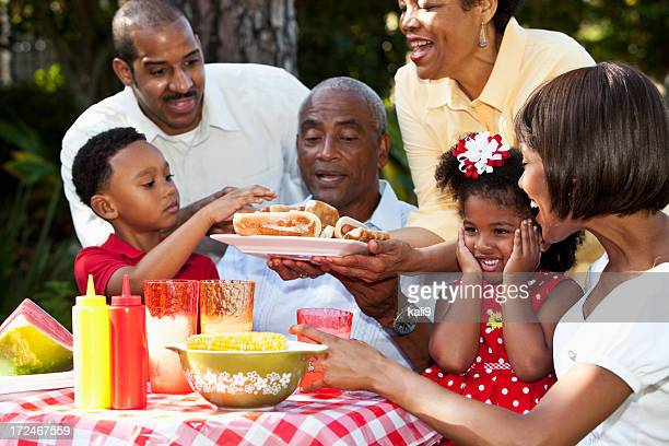 Multi-generation family at picnic table