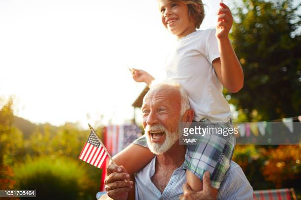 multi-generation family celebrating 4th of july - patriotic stock pictures, royalty-free photos & images