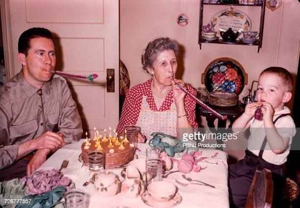 multi-generation family celebrating birthday - archival stock pictures, royalty-free photos & images