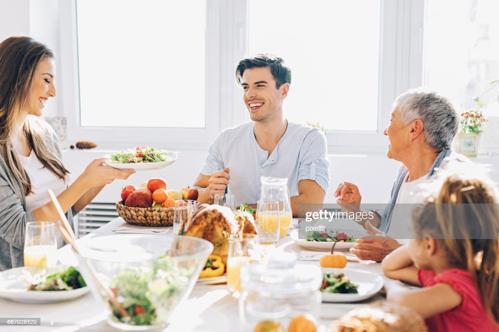 Multi-generation family celebrating Thanksgiving : Stock Photo