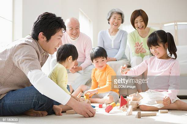 multi-generation family, children playing with blocks - japanese girls hot stock photos and pictures