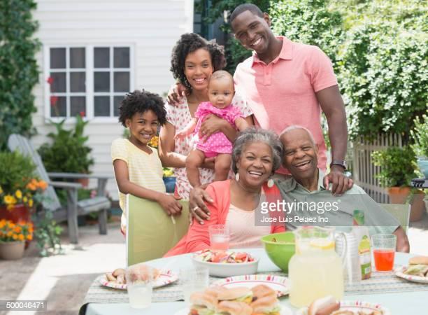Multi-generation family enjoying barbecue