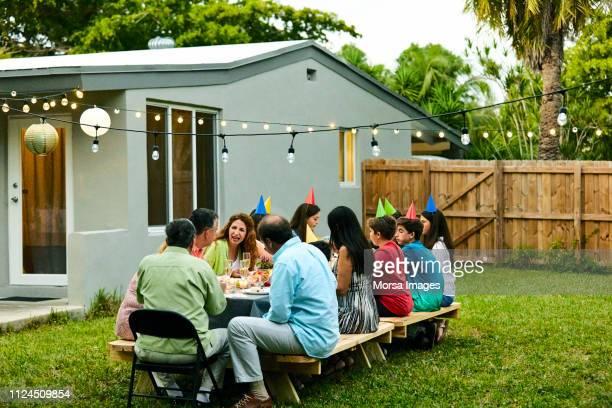 multi-generation family enjoying birthday party - of miami photos stock pictures, royalty-free photos & images
