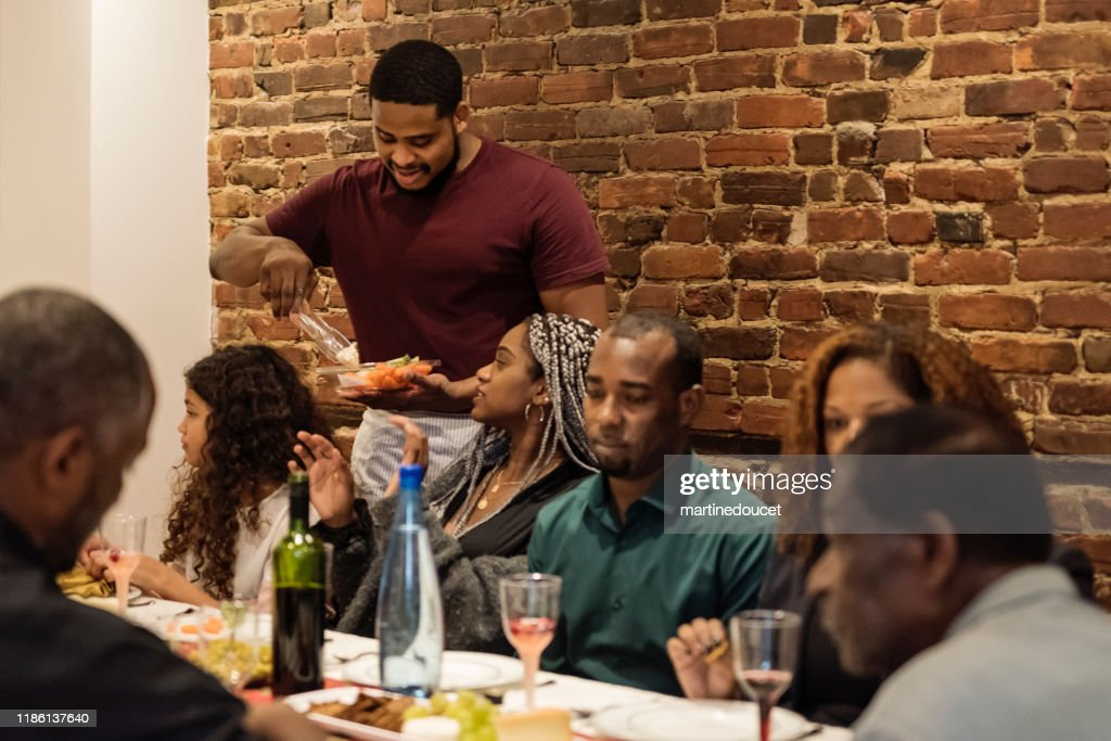 Multi-generation family enjoying Thanksgiving dinner. : Stock Photo