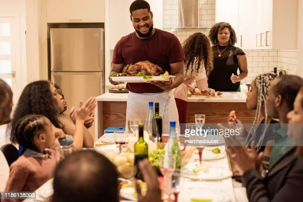 multi-generation family enjoying thanksgiving dinner. - canadian thanksgiving stock pictures, royalty-free photos & images