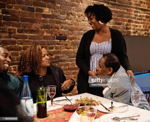 """multi-generation family enjoying thanksgiving dinner. - """"martine doucet"""" or martinedoucet imagens e fotografias de stock"""