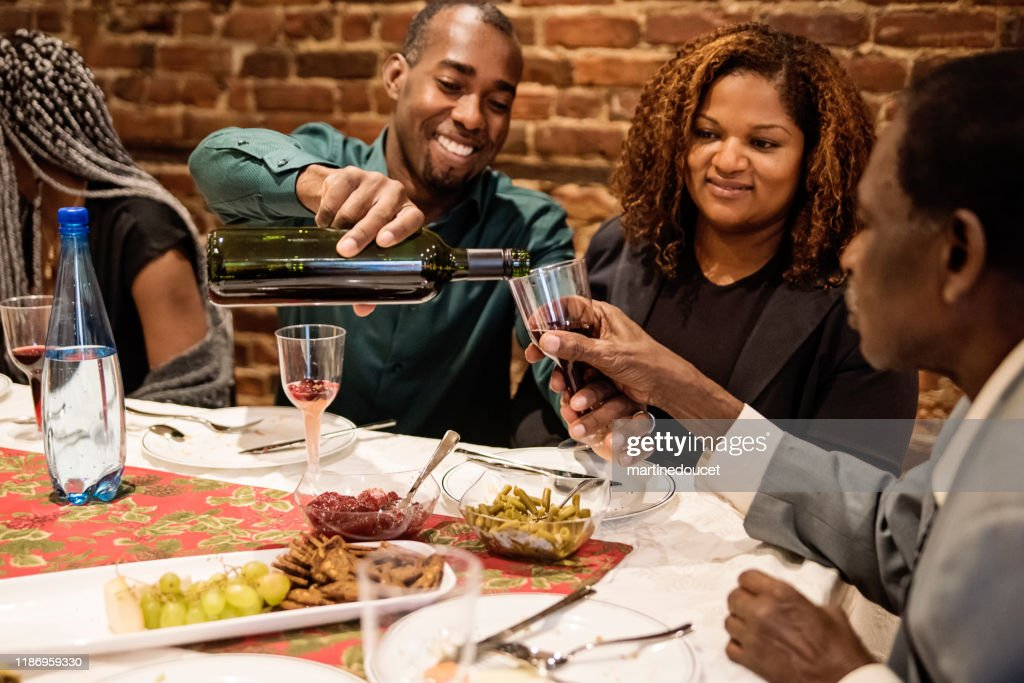 Multi-generation family enjoying Thanksgiving dinner. : Stock Photo