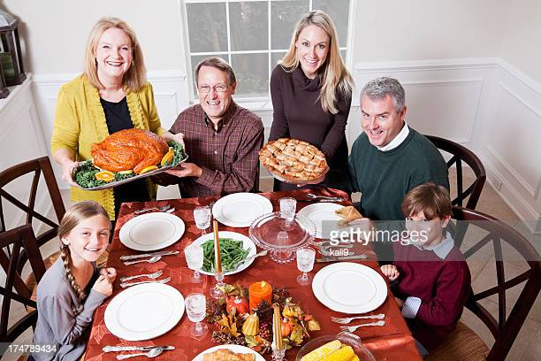 Multi-generation family enjoying traditional holiday dinner