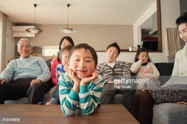 Multi-generation family having fun in the living room