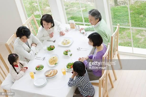 Multi-generation family having meal, high angle view