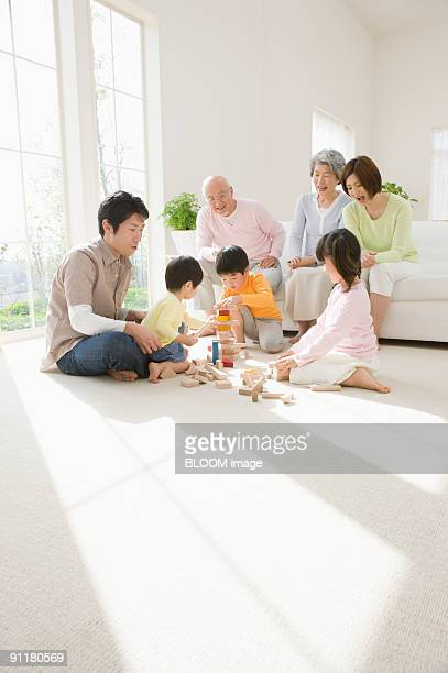 multi-generation family in living room - japanese girls hot stock photos and pictures
